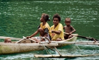 A mother and her kids on a wooden boat
