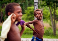 A skinny Papuan boy with his carefree smile
