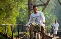 Holding the iron rod while cross the bridge